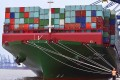 Onlookers watch as the largest container ship in world, CSCL Globe, docks during its maiden voyage, at the port of Felixstowe in south east England. Photo: Reuters
