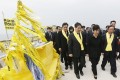 South Korean President Park Geun-hye, center front, passes by yellow ribbons tied with messages for the victims of the sunken ferry Sewol as she arrives to offer her condolences to the bereaved relatives of the victims at a port in Jindo. Photo: AP