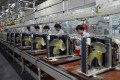 Workers assemble air conditioners at a Gree factory. Now the firm has joined the smartphone market. Photo: EPA