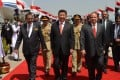 President Xi Jinping (centre) walks with Pakistani President Mamnoon Hussain (left) and Prime Minister Nawaz Sharif after his arrival in Pakistan. Photo: AFP