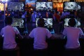 Gamers play Starcraft at an industry trade show in Germany. New technology uses online strategy games to transmit data and bypass censorship tools. Photo: Reuters
