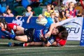 South Korea's Chang Yong-heung crosses over to score despite the attention of Hong Kong fly-half Niall Rowark. Photos: HKRFU