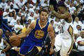 Stephen Curry drives against the Pelicans. Photo: AP