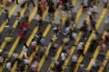 People cross a street in Mong Kok district in Hong Kong. Photo: Reuters