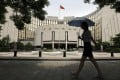 The People's Bank of China is taking a more measured approach than the central banks of the US, Japan and Europe. Photo: Reuters