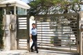 A policeman outside the consul's residence.Photo: SCMP Pictures