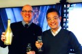 Michael Ching Mo Yeung (right) and Opus Hotel Corp president John Evans, toast the agreement to create an Opus hotel in Ching's International Trade Centre development near the Vancouver International Airport, in this image posted to Twitter by Evans on December 16. Photo: Twitter