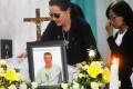 Angelita Muxfeldt, left, a cousin of Brazilian death row convict Rodrigo Gularte, touches Gularte's coffin at a funeral home in Jakarta. Photo: AP