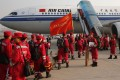 Chinese rescue personnel board a flight to Nepal. Photo: AFP