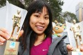 Christy Yiu with 10km and women's overall trophies from the Hong Kong Marathon last year. Photo: David Wong