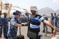 A crew member of the PLA frigate Linyi searches an evacuee in Aden, Yemen last month. The ship and two other Chinese warships have sailed to the Mediterranean Sea for joint exercises with the Russian Navy. Photo: SCMP Pictures