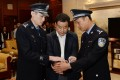 China's corrupt former official Li Huabo was arrested upon arrival in Beijing last Saturday. Photo: Xinhua