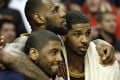 LeBron James watches the end of the game with guard Kyrie Irving, left, and centre Tristan Thompson. Photo: AP