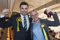 Scottish National Party member Mhairi Black (right) with another newly elected member of parliament, Gavin Newlands. Photo: AFP