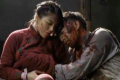 Actress Ge Tian (left), pictured here playing the lover of a jailed communist in a war-themed soap opera, hides a grenade underneath her dress.