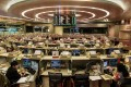 The trading floor of the Hong Kong stock exchange where shares of Hanergy were suspended after dropping 47 per cent on Wednesday. Photo: AFP