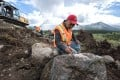 Alan Qiao, CEO of Dease Lake Jade Mines, inspects a boulder at the firm's Wolverine mine site in far northern British Columbia. Photo: SCMP Picture/Handout
