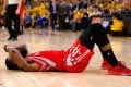 James Harden of the Houston Rockets lies slumped on the court after being denied a game-winning shot against the Golden State Warriors in game two of the Western Conference finals. Photo: AFP