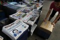 A newspaper stand in Hong Kong, where dailies are struggling to survive the disruptive impact of the internet on the business. Photo: Reuters