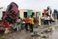 Residents survey the destruction wrought by a tornado that flung cars and razed homes in the Mexican town of Ciudad Acuna. Photo: Reuters