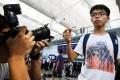Joshua Wong displays his boarding pass at Hong Kong International Airport after Malaysian authorities refused him entry and ordered him to return. Photo: Sam Tsang