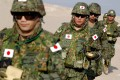 Soldiers from the Japanese Ground Self Defence Force take part in a drill at a desert in Northern Kuwait in 2004, in a preparation to join the Japanese contingent in Iraq. Photo: AFP