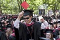 A file photo of a successful Chinese student in the US. Roughly 15 per cent of Chinese students who studied there last year failed to graduate, including the 3 per cent who were expelled, according to a report.