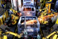 Robots weld car bodies in a factory in Liuzhou in Guangxi province. Automation and digitalisation could help offset declining productivity and a shrinking workforce as the population ages. Photo: ImagineChina