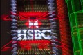 The HSBC logo is seen lighting up the building of the lender in Hong Kong. Sky News is reporting HSBC may announce thousands of job cuts next week. Photo: EPA