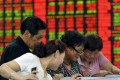 Beijing wants mainland retail investors to buy stocks to help raise the ratio of equity market capitalisation to loans. Photo: Reuters