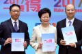 Carrie Lam, accompanied by Rimsky Yuen (left) and Raymond Tam, promotes the political reform package. Photo: Sam Tsang