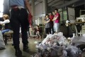 Chinese labourers questioned at a factory in Prato, Italy. Photo: AP