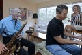 Al Karp and his son Larry and wife Saundra have to resort to performing to raise funds to save their home. Photo: AP