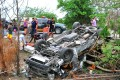 The overturned van struck a tree after skidding. Photo: Thai Rath