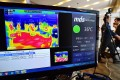 A thermal camera system monitors the body heat of visitors at an exhibition hall in Seoul. Photo: AFP