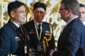 Admiral Sun Jianguo chats with US Secretary of Defence Ashton Carter during the ministerial luncheon at the  Shangri-La Dialogue in Singapore. Photo: AFP