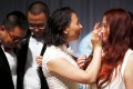 Xu Na wipes tears from the face of her new wife, Xue Meng Yao, at their wedding in West Hollywood on Monday. Photo: Reuters