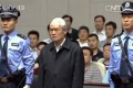 A white-haired Zhou Yongkang admits his guilt in court and says that he will not appeal. Photo: CCTV