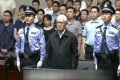 A white-haired Zhou Yongkang, China's former domestic security tsar, stands in court in Tianjin as he is sentenced on Thursday. Photo: Reuters