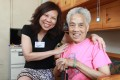 Happy Grannies founder Sindy Chow Chi-fun poses for a picture with Cheng Tim, 84, in her home in Cheung Sha Wan. Photo: May Tse