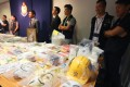 Police display material including Guy Fawkes masks seized in raids on Monday - but some social media users questioned if the bomb plot was real. Photo: David Wong