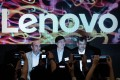 The listing could spell good news for Lenovo CEO Yang Yuanqing (centre) by freeing up funds for Legend to buy more complementary subsidiaries. Photo: AFP