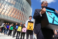 A group of activists, including members of the Progressive Lawyers Group, hold placards outside Legco. Photo: Felix Wong