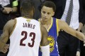 LeBron James congratulates Stephen Curry. Photo: AP