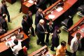 Pro-establishment lawmakers head for the exits moments before the crunch vote on electoral reform. Photo: Jonathan Wong