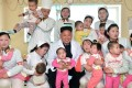 North Korean leader Kim Jong-un (centre) poses with nurses and doctors in a facility for orphaned children and babies at Taesongsan General Hospital in Pyongyang. Photo: AFP