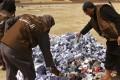 Hisba members prepare to burn cigarettes in Syria.Photo: AP
