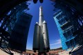 A rocket in China is moved to its launch platform, as CMMB Vision Holdings said it entered into an agreement to an L-band satellite platform from a US-based firm. Photo: AFP