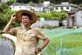 David Tsang Wai-keung, chairman of the Cultural Development Society of Lai Chi Wo Hong Kong, in front of a thriving rice paddy in Lai Chi Wo village. Photo: May Tse