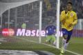 Brazil's Roberto Firmino scores past Venezuela's goalie Alain Baroja. Photo: Reuters